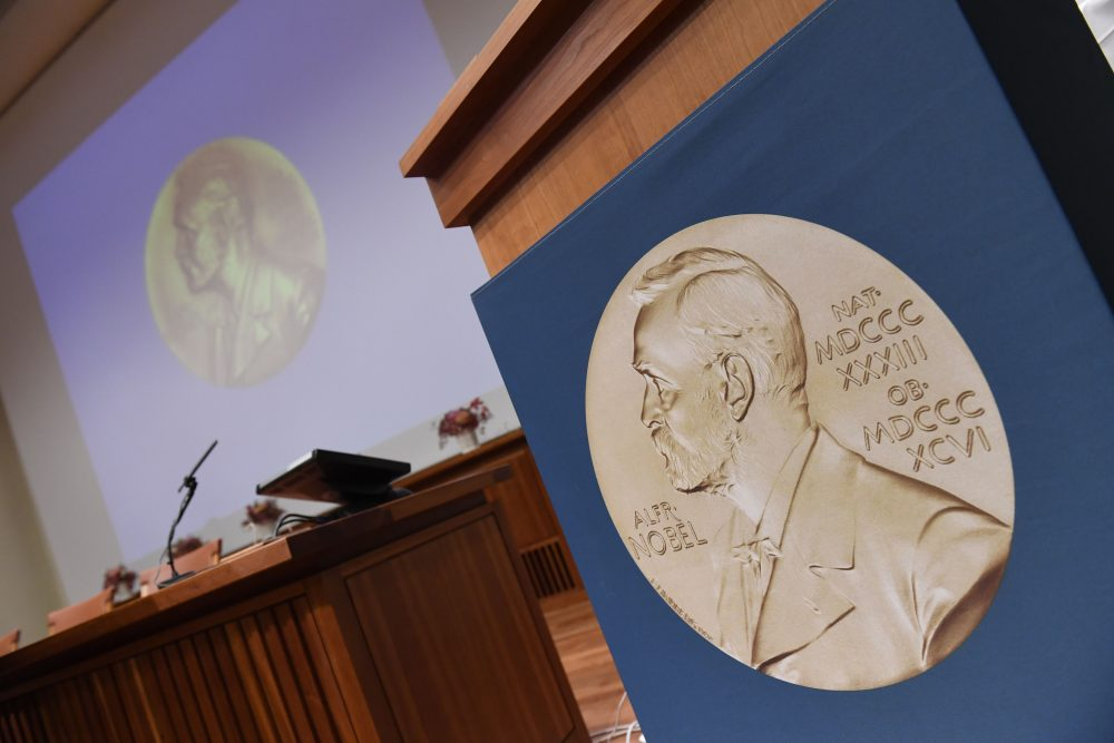 A portrait of Swedish inventor and scholar Alfred Nobel can be seen on the speaker's desk at the Nobel Forum in Stockholm, prior to the announcement of the Nobel Prize in Medicine on Oct. 3, 2016. (Jonathan Nackstrand/AFP/Getty Images)
