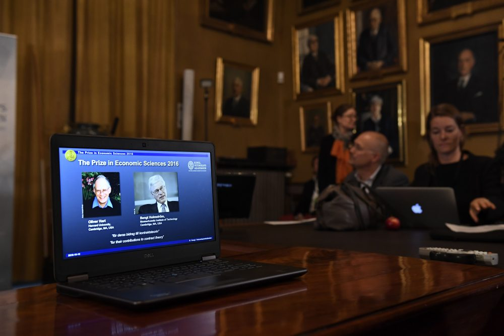 British-American economist Oliver Hart (left) and Bengt Holmstrom of Finland, are displayed on a screen during a press conference to announce the winner of the 2016 Nobel Prize in Economic Sciences at the Royal Swedish Academy of Sciences in Stockholm on Oct. 10, 2016. (Jonathan Nackstrand/AFP/Getty Images)