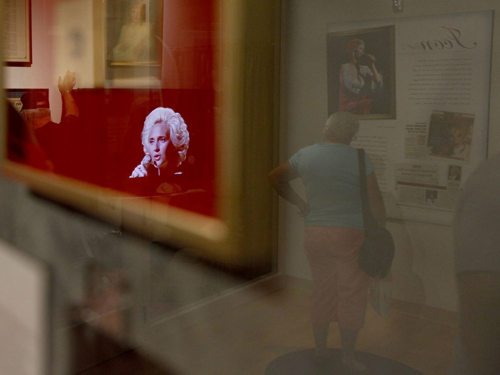 In this Sept. 15, 2010 photo, a video of Tammy Wynette is reflected in a glass case at the Tammy Wynette exhibit at The Country Music Hall of Fame in Nashville, Tenn. (Josh Anderson/AP)
