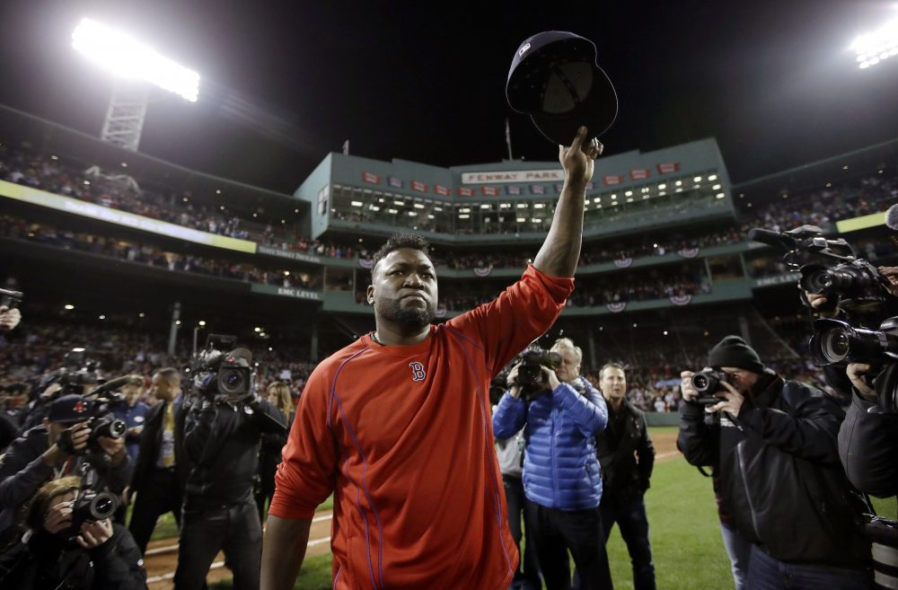 Boston Red Sox's David Ortiz waves from the field at Fenway Park after Game 3 of baseball's American League Division Series against the Cleveland Indians in Boston. (Charles Krupa/AP)