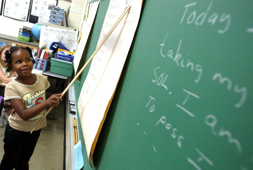 Marshawnda Overstreet, 9, points to the chalkboard during a lesson on reading Thursday, May 27, 2004, at B.C. Charles Elementary School in Newport News, Va. (Jason Hirschfeld/AP)