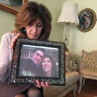 Debbie Deagle holds a photo of her son Stephen and herself. (Martha Bebinger/WBUR)