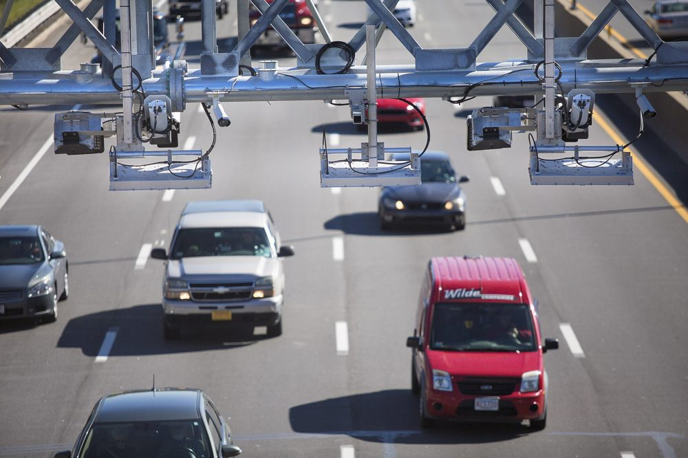 """The state's move to all-electronic tolling means drivers without an E-ZPass transponder will pay more. Drivers who don't have an E-ZPass will have a six-month """"grace period,"""" in which they can apply for one and get credited the difference between their bill and the lower E-ZPass rate. (Jesse Costa/WBUR)"""