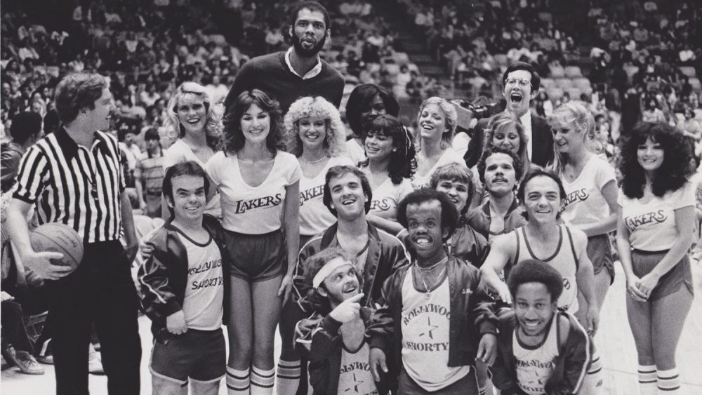 The Shorties in their first game versus the Laker Girls in December 1981. Kareem Abdul-Jabbar photobombs in the background, and Paula Abdul is featured in the center. (Andrew Bernstein)