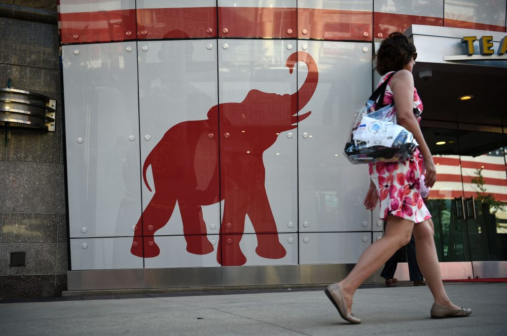 A woman walks past the elephant logo of the Republican Party on the first day of the Republican National Convention on July 18, 2016 in Cleveland, Ohio. (Dominick Reuter/Getty Images)