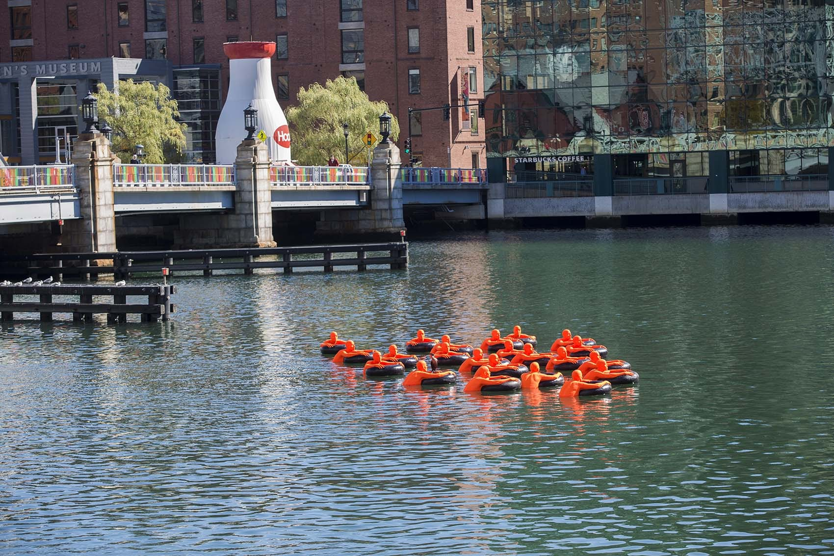 """""""SOS (Safety Orange Swimmers)"""" as seen in the Fort Point Channel. (Jesse Costa/WBUR)"""