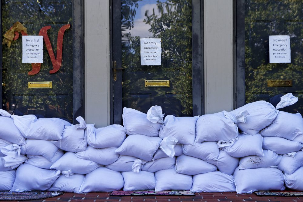 Sandbags and no entry signs are seen in front of apartments located near the Tar River as floodwaters associated with Hurricane Matthew continue to rise on Wednesday, Oct. 12, 2016, in Greenville, N.C. The city is about half an hour south of Princeville, N.C. (Brian Blanco/AP)