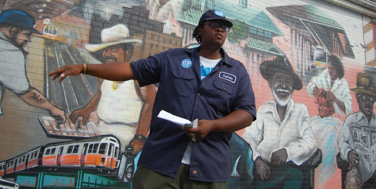 Cedric douglas at the faces of dudley mural in roxbury