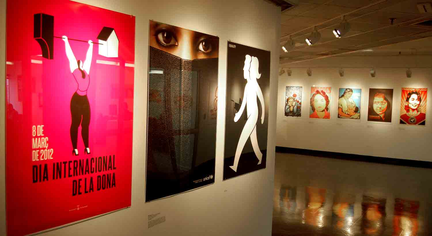 """Women's Rights Are Human Rights"" poster exhibit at Massachusetts College of Art and Design. (Greg Cook/WBUR)"
