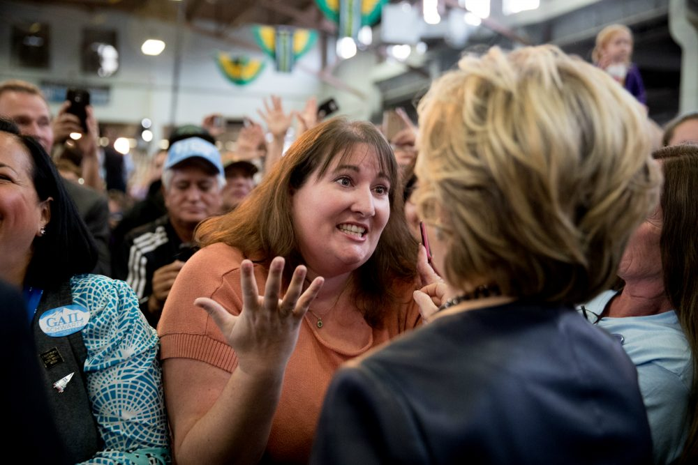 Democratic presidential candidate Hillary Clinton speaks with a woman in the audience during a rally at the Colorado State Fairgrounds in Pueblo, Colo., Oct. 12, 2016. (Andrew Harnik/AP)