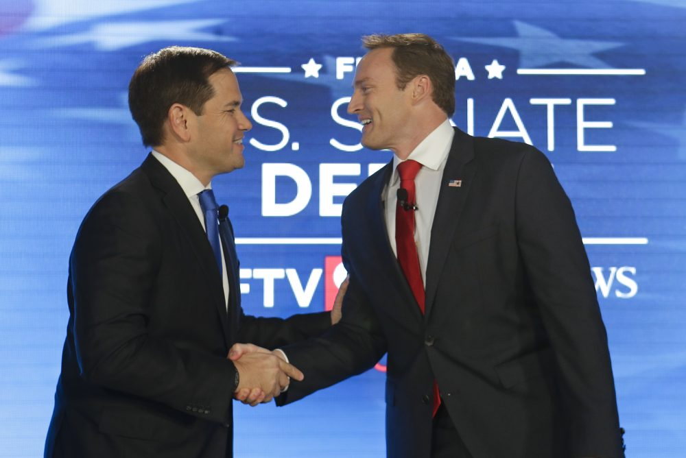 Sen. Marco Rubio, R-Fla., left, and Rep. Patrick Murphy, D-Fla., shake hands before their debate at the University of Central Florida, Monday, Oct. 17, 2016, in Orlando, Fla. (John Raoux/AP)