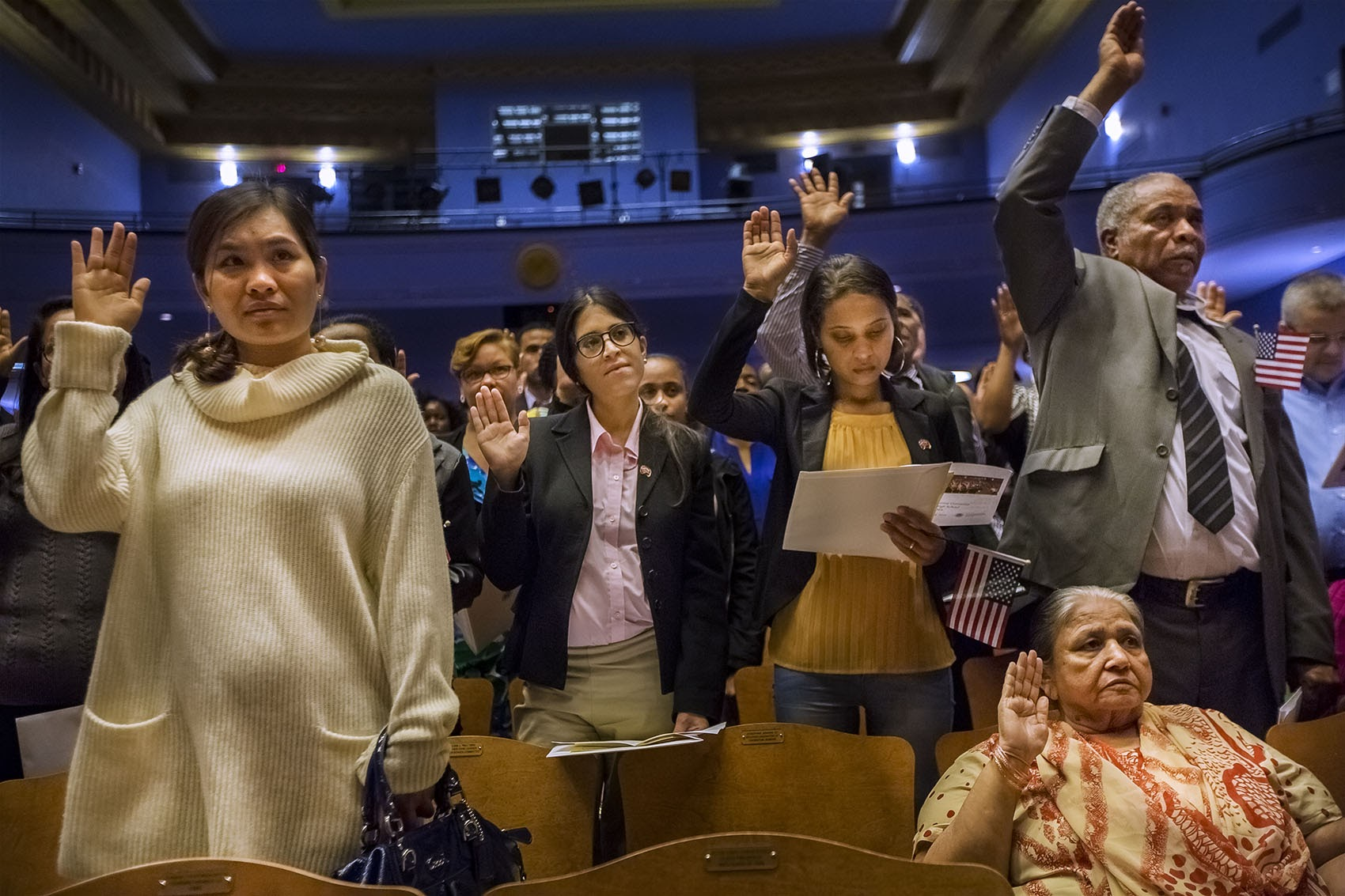 Close to 150 naturalization applicants took the Oath of Allegiance during a ceremony at Jenkins Auditorium at Malden High School on Oct. 18. (Jesse Costa/WBUR)