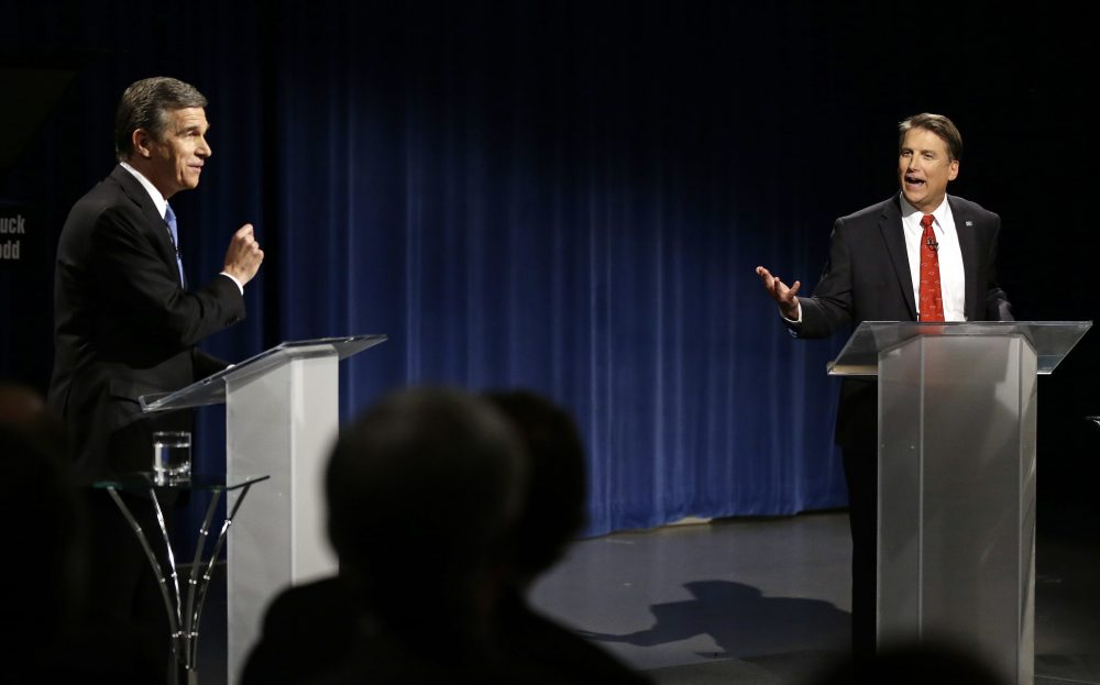 Democratic gubernatorial candidate Attorney General Roy Cooper, left, and North Carolina Republican Gov. Pat McCrory participate in a live televised debate at UNC-TV studios in Research Triangle Park, N.C., Tuesday, Oct. 11, 2016. (Gerry Broome, Pool/AP)