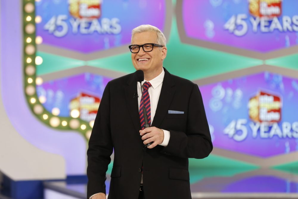"On the episode of ""The Price is Right"" airing Monday, Oct. 17, 2016, a trio of contestants spun $1 on the game show's famous wheel. The three contestants each landed on different combinations of $1 in a pair of spins during one of the show's ""Showcase Showdowns."" Host Drew Carey pumped his fist in the air after the contestants achieved the first three-way tie in the show's history. (Monty Brinton/CBS via AP)"