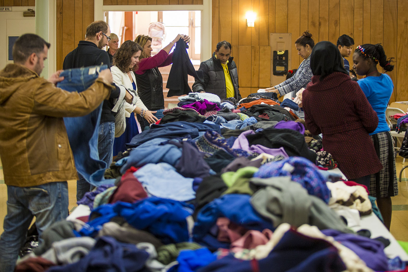 Refugees pick out items at a clothing drive at First United Baptist Church in Lowell. (Jesse Costa/WBUR)