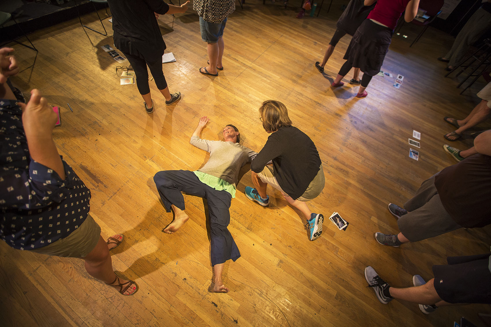 """In a workshop with Actors' Shakespeare Project, teachers perform their interpretations of """"Hamlet"""" based on visual images. (Jesse Costa/WBUR)"""