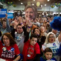 A young man in the audience holds a mask depicting Democratic presidential candidate Hillary Clinton and cheers as she speaks at a rally at the Colorado State Fairgrounds in Pueblo, Colo., Wednesday, Oct. 12, 2016. (Andrew Harnik/AP)