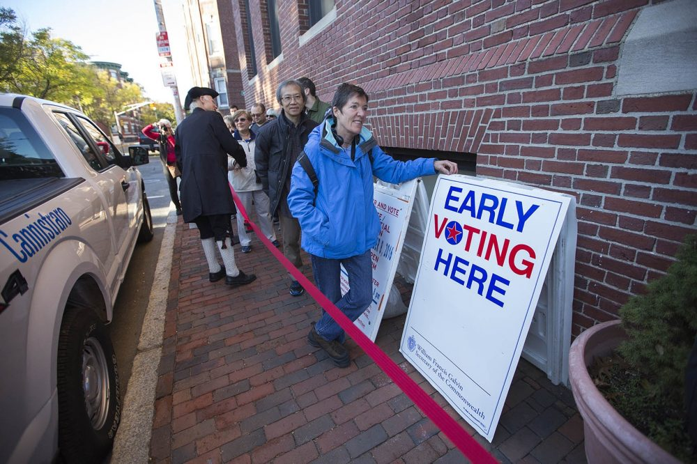 Cambridge voters wait in line on Inman Street to cast their ballots early on Monday, the first day of early voting in the state. (Jesse Costa/WBUR)