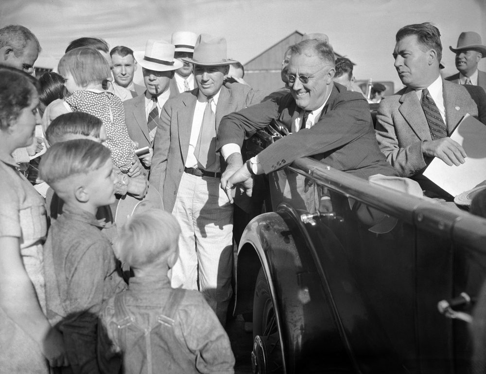 President Franklin Roosevelt, pictured getting drought information first-hand in his car as he talked with farmer Will Duerr and his family in Julesburg, Colo. on Sept. 3, 1936. Roosevelt won the state in the 1932 and 1936 presidential elections. (AP)