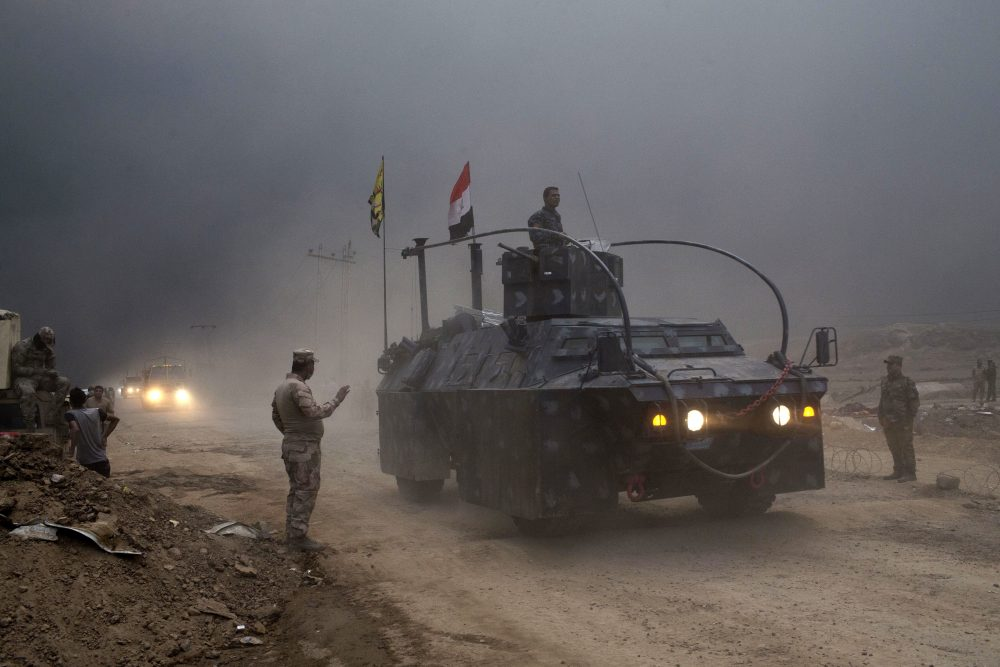 An Iraqi Federal Police vehicle passes through a checkpoint in Qayara, south of Mosul, Iraq, Wednesday, Oct. 26, 2016. Islamic State militants have been going door to door in farming communities south of Mosul, ordering people at gunpoint to follow them north into the city and apparently using them as human shields as they retreat from Iraqi forces. (Marko Drobnjakovic/AP)