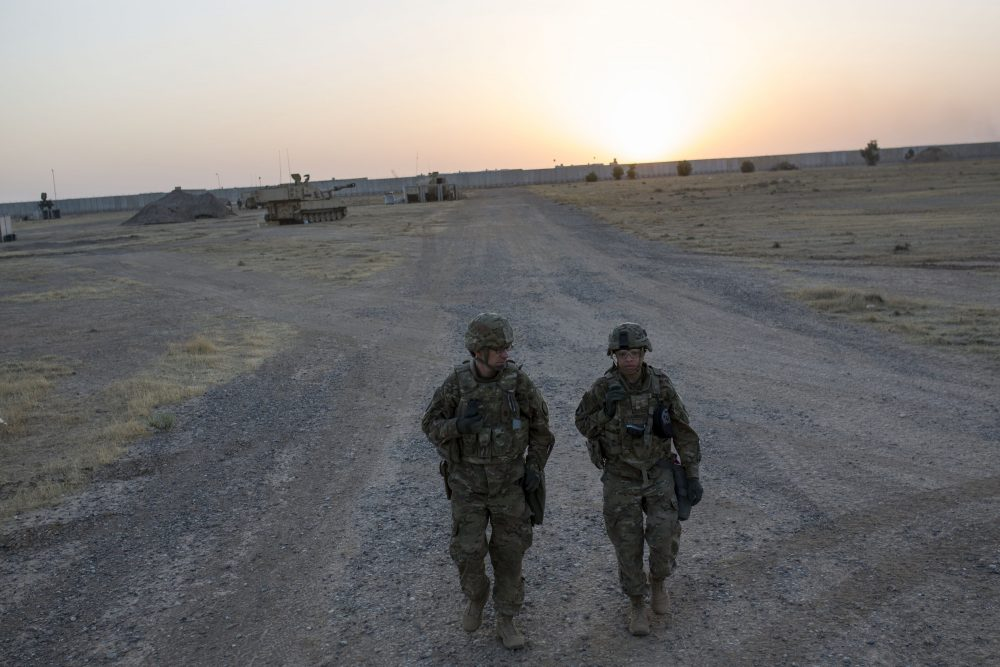 U.S. soldiers walk at the Qayyarah military base during the ongoing operation to recapture Mosul, the last major Iraqi city under the control of the Islamic State (IS) group jihadists, on Oct. 20, 2016. (Yasin Akgul/AFP/Getty Images)