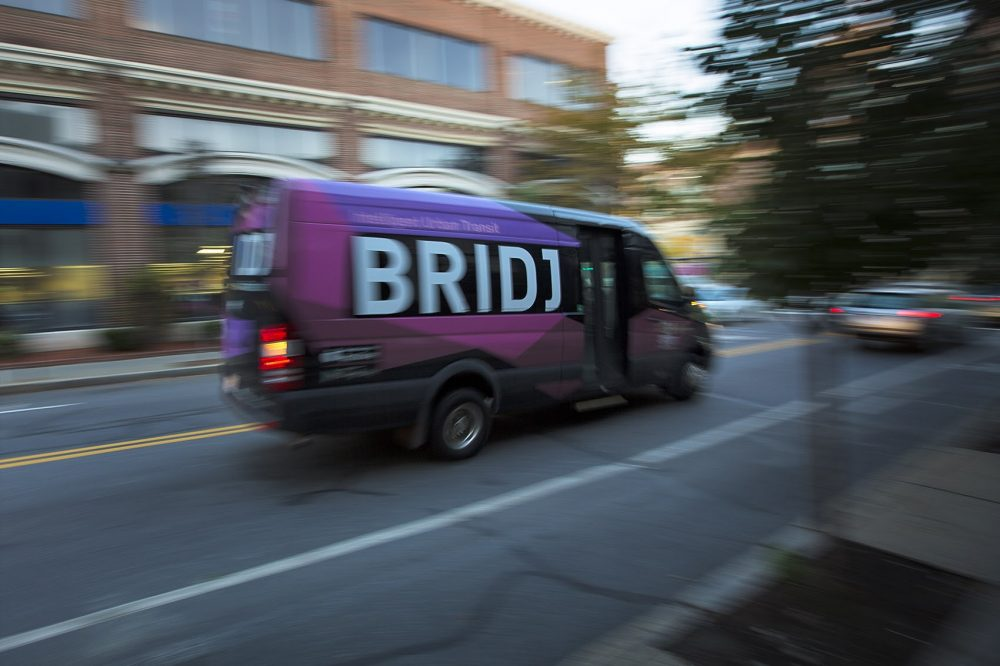 A Bridj bus travelling down St. Paul St. in Brookline. (Jesse Costa/WBUR)