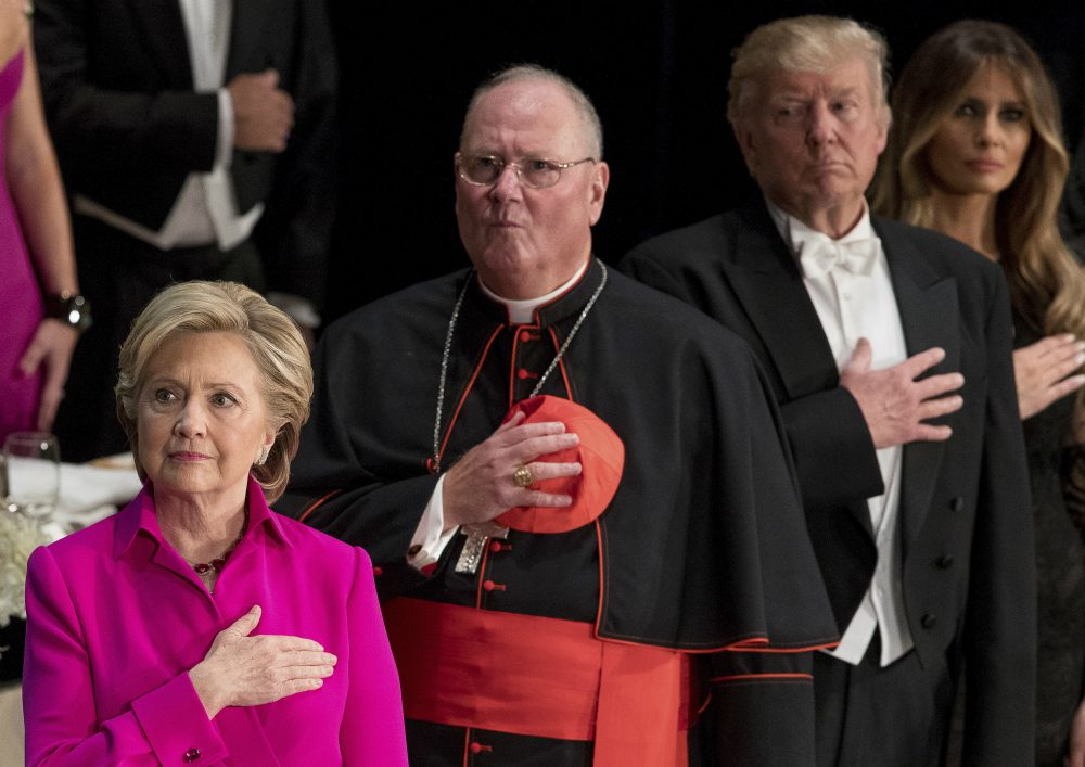 From left, Democratic presidential candidate Hillary Clinton, Cardinal Timothy Dolan, Archbishop of New York; Republican presidential candidate Donald Trump, and his wife Melania Trump, stand for the National Anthem at the 71st annual Alfred E. Smith Memorial Foundation Dinner, a charity gala organized by the Archdiocese of New York, Thursday, Oct. 20, 2016, at the Waldorf Astoria hotel in New York. (Andrew Harnik/AP)