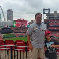 Dave and Tommy MacDougall, pictured here at Busch Stadium in St. Louis, are halfway through their journey to spread Johnny's ashes at every ballpark across the country. (Courtesy of Dave MacDougall)
