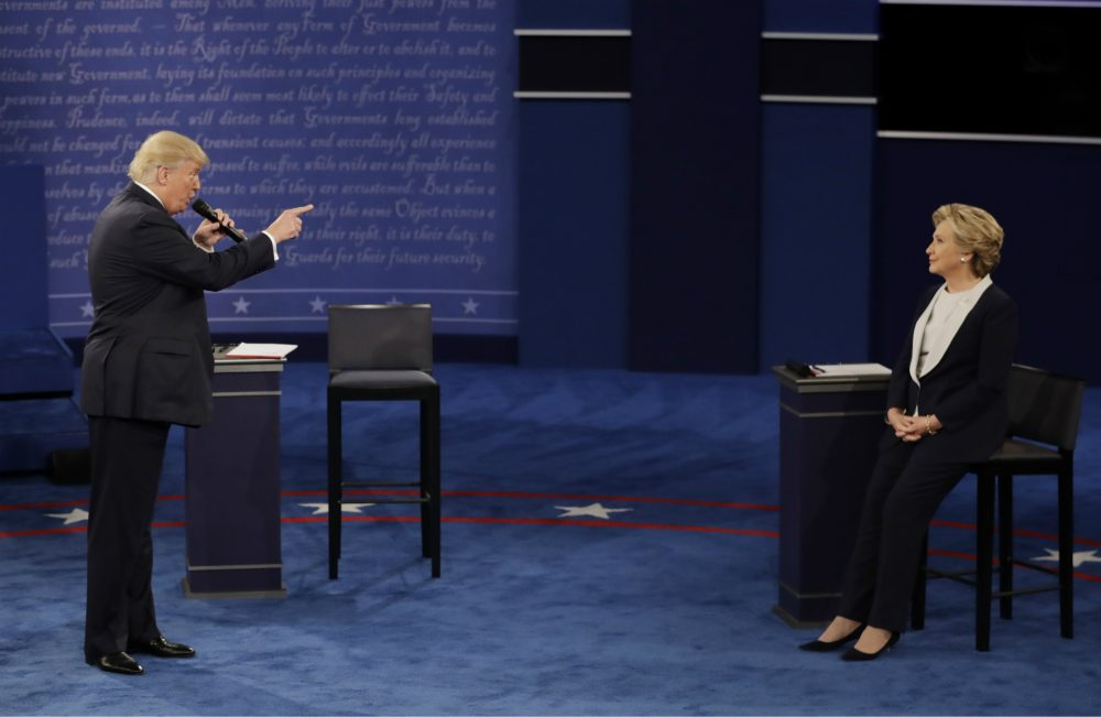 Trump's performance on Sunday night was the single most depressing political event of my lifetime, writes Steve Almond. By the end of it, I wasn't angry or indignant or even triumphant. I was just incredibly sad. Pictured: Republican presidential nominee Donald Trump speaks to Democratic presidential nominee Hillary Clinton during the second presidential debate at Washington University in St. Louis, Sunday, Oct. 9, 2016. (Patrick Semansky/AP)