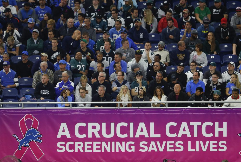 A breast cancer awareness sign is shown during an NFL game between the Detroit Lions and Philadelphia Eagles in Detroit on Sunday. (Paul Sancya/AP)