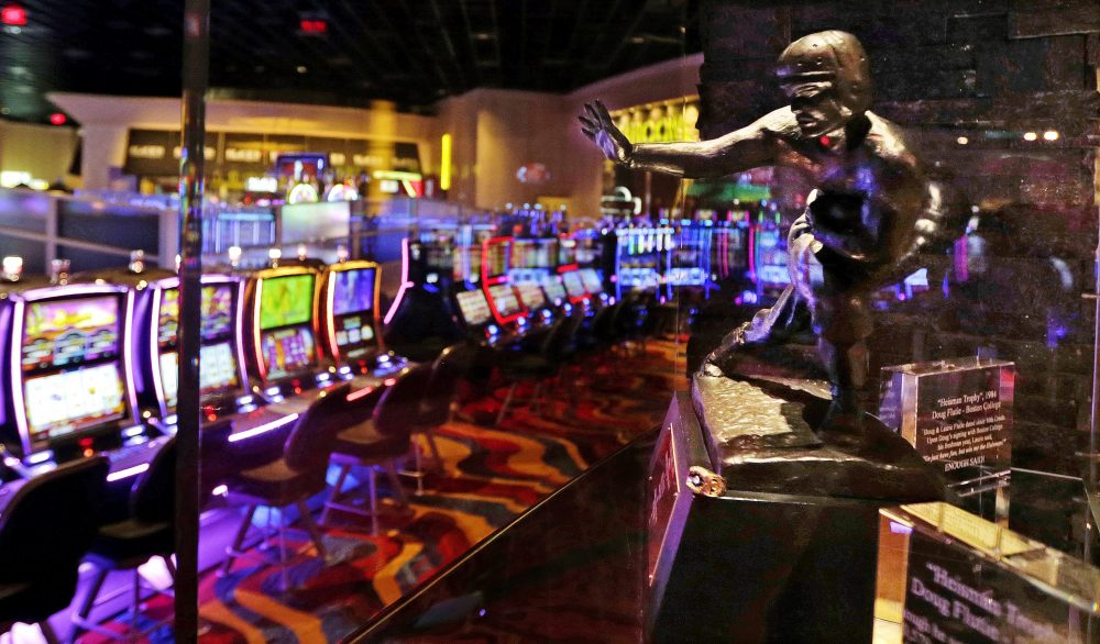 The Heisman Trophy, won in 1984 by Boston College quarterback Doug Flutie, is displayed at the Plainridge Park Casino in Plainville. (Charles Krupa/AP)