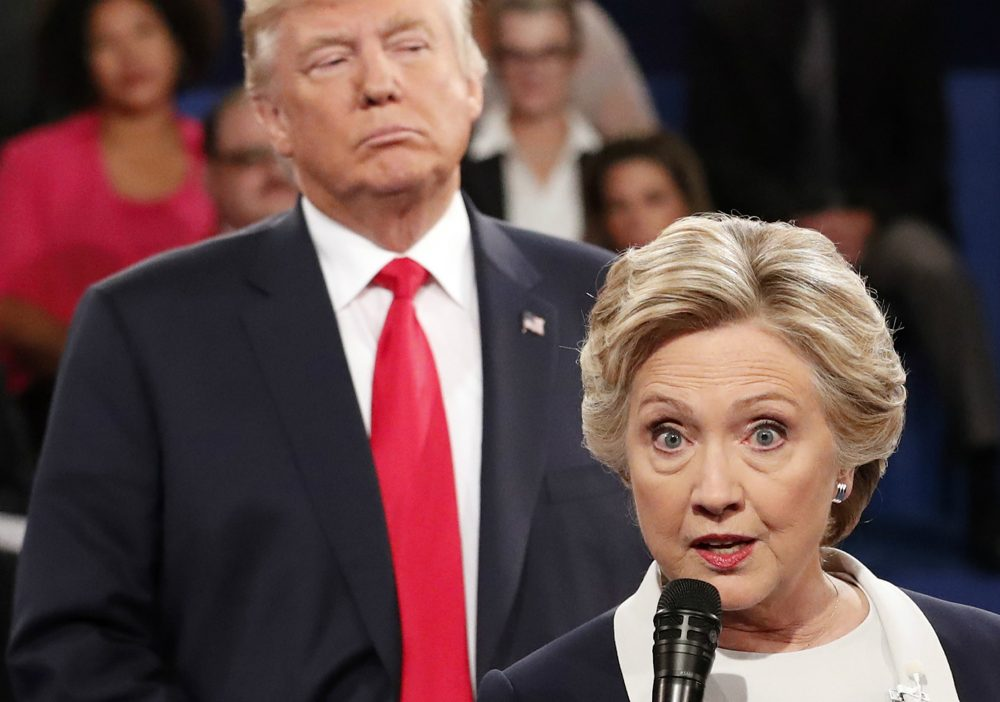 Democratic presidential nominee Hillary Clinton, right, speaks as Republican presidential nominee Donald Trump listens during the second presidential debate at Washington University in St. Louis, Sunday, Oct. 9, 2016. (Rick T. Wilking/AP)