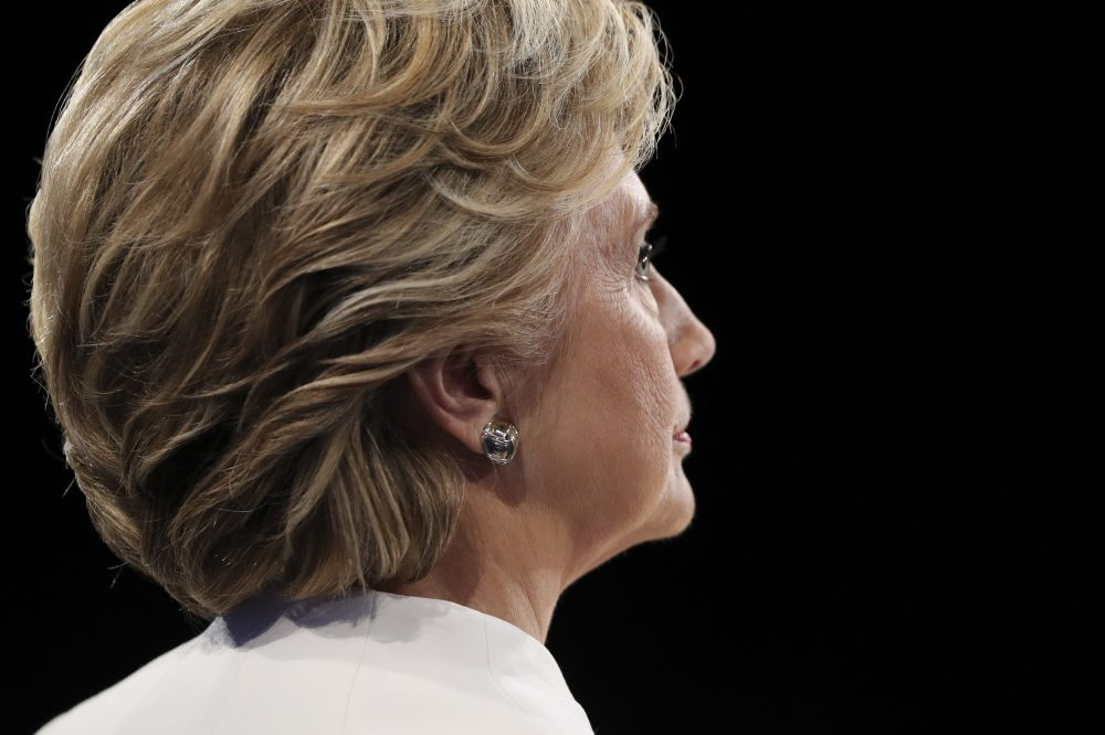 Democratic presidential nominee Hillary Clinton listens as Republican presidential nominee Donald Trump answers a question during the third presidential debate at UNLV in Las Vegas, Wednesday, Oct. 19, 2016. (Joe Raedle/AP)