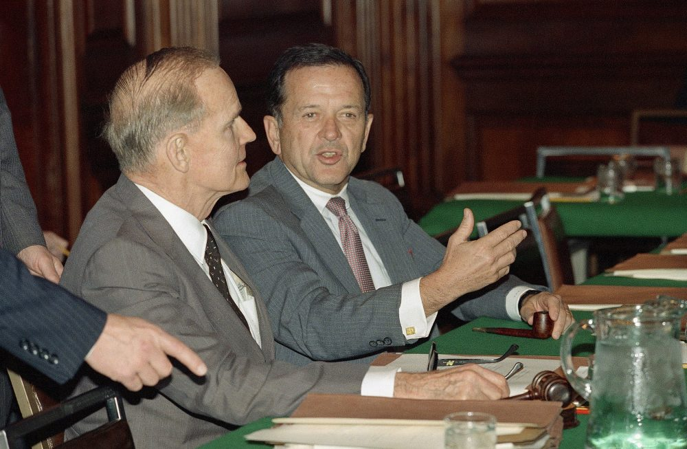 "Sen. Ted Stevens (R-Alaska), right, speaks with Sen. William Proxmire (D-Wis.), during a meeting of budget conferees on Capitol Hill in Washington, on Dec. 22, 1987. The conferees decided to remove the ""Fairness Doctrine"" from the budget bill, one of the obstacles preventing the passage of the bill. (Doug Mills/AP)"