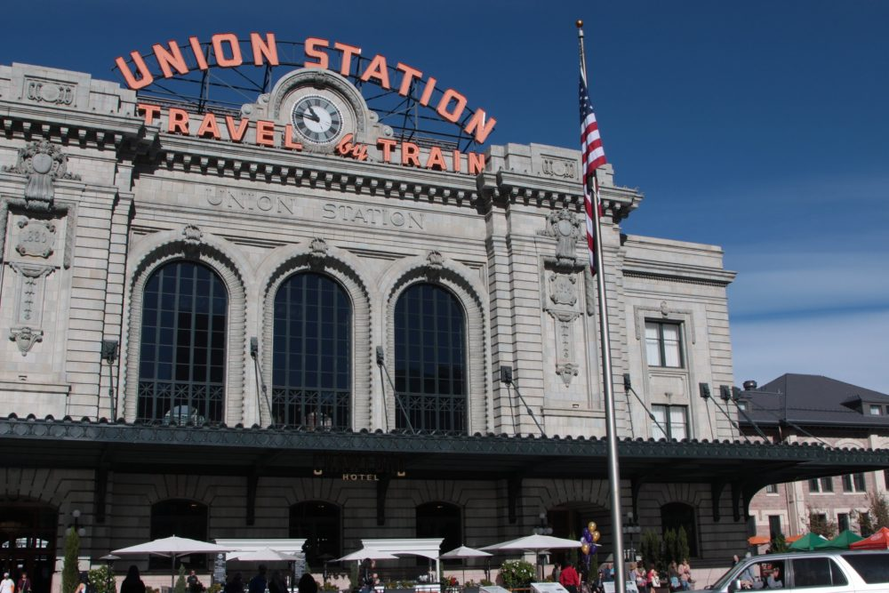 Denver Union Station in the district of LoDo. The historic terminal building includes a train shed canopy, underground bus facility and light rail station. (Dean Russell/Here & Now)