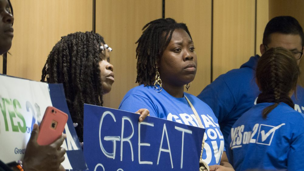 Pro-charter parents look on at the Boston School Committee meeting Wednesday night. (Max Larkin/WBUR)