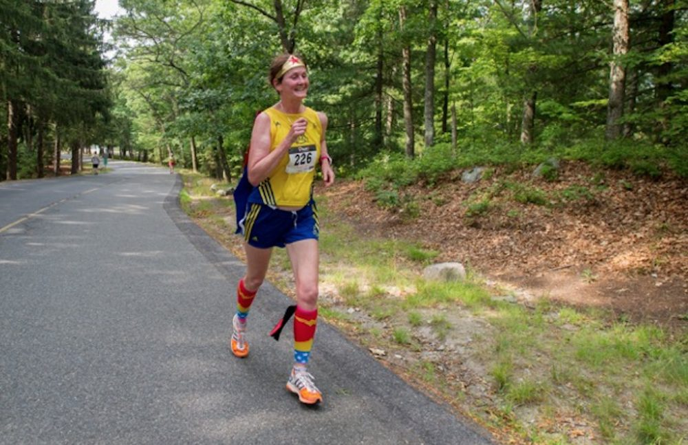"Carol Chaoui runs a race in Brockton in July. ""Since I can no longer run fast,"" she says, ""I am usually in a Wonder Woman costume!"" (Courtesy of the author)"