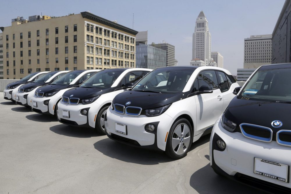 Electric cars are parked atop the Los Angeles Police Department parking lot, in Los Angeles. (Nick Ut/AP)