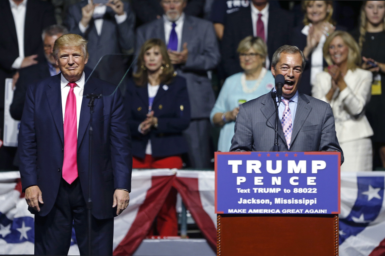Nigel Farage, ex-leader of the British UKIP party, speaks as Republican presidential candidate Donald Trump, left, listens, at Trump's campaign rally in Jackson, Miss. (Gerald Herbert/AP)