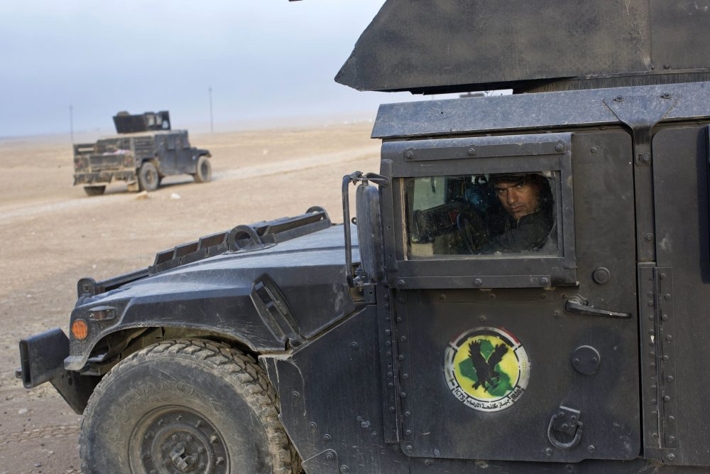 An Iraqi special forces soldier drives a Humvee close to the in the village of Bazwaya, some eight kilometers from the center of Mosul, Iraq, Monday, Oct. 31, 2016. (Marko Drobnjakovic/AP)