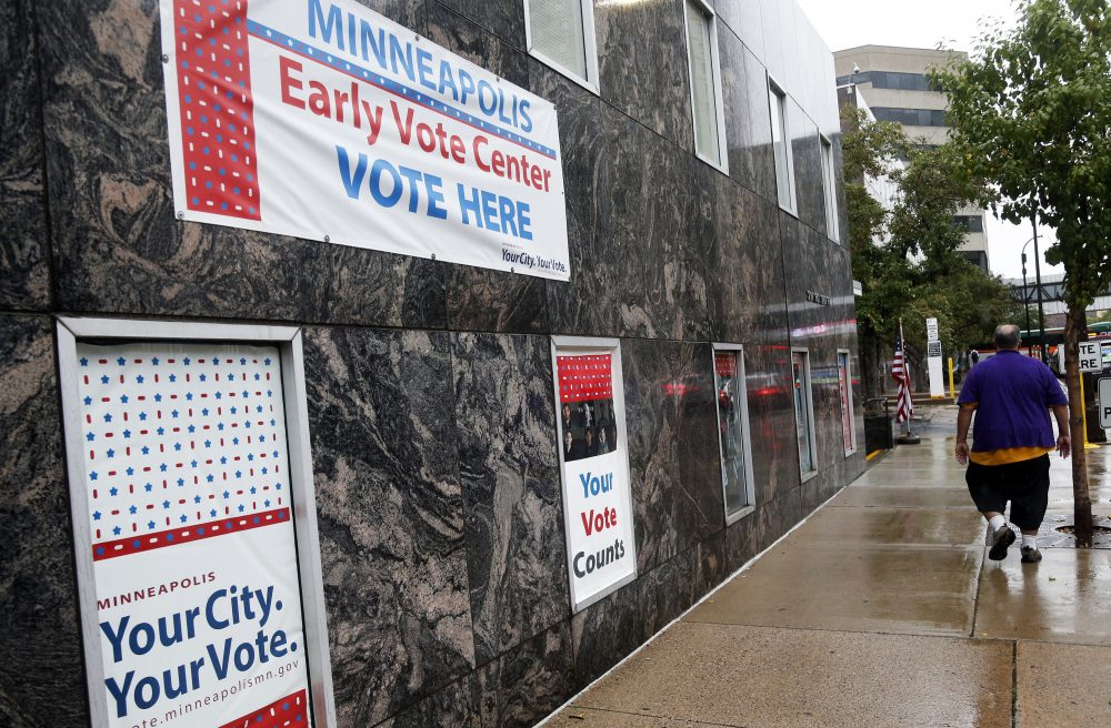Signs on a building advertise early voting Friday, Sept. 23, 2016, in Minneapolis. Minnesota is one of several states that have rules permitting early voters to change their ballots. (Jim Mone/AP)