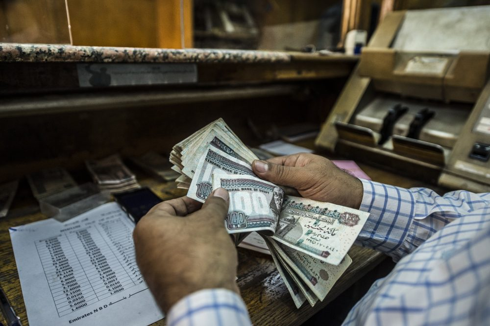 A man counts Egyptian pounds at currency exchange shop in downtown Cairo on Nov. 3, 2016. (Khaled Desouki/AFP/Getty Images)