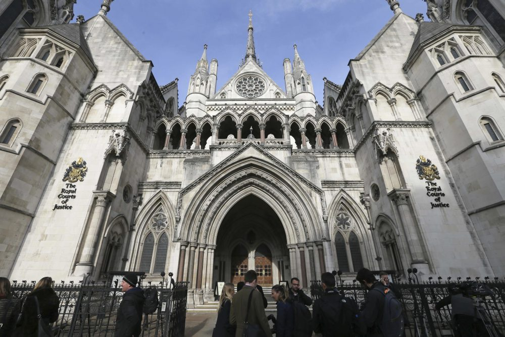Media gather outside the High Court in London on Thursday Nov. 3, 2016. In a major blow for Britain's government, the High Court ruled Thursday that the prime minister can't trigger the U.K.'s exit from the European Union without approval from Parliament. (Tim Ireland/AP)