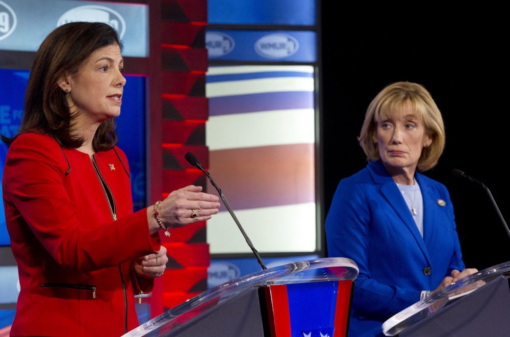 U.S. Senate Republican incumbent Kelly Ayotte, left, speaks as and Democratic challenger Gov. Maggie Hassan listens during a live televised debate on Wednesday in Manchester, New Hampshire. (Jim Cole/AP)