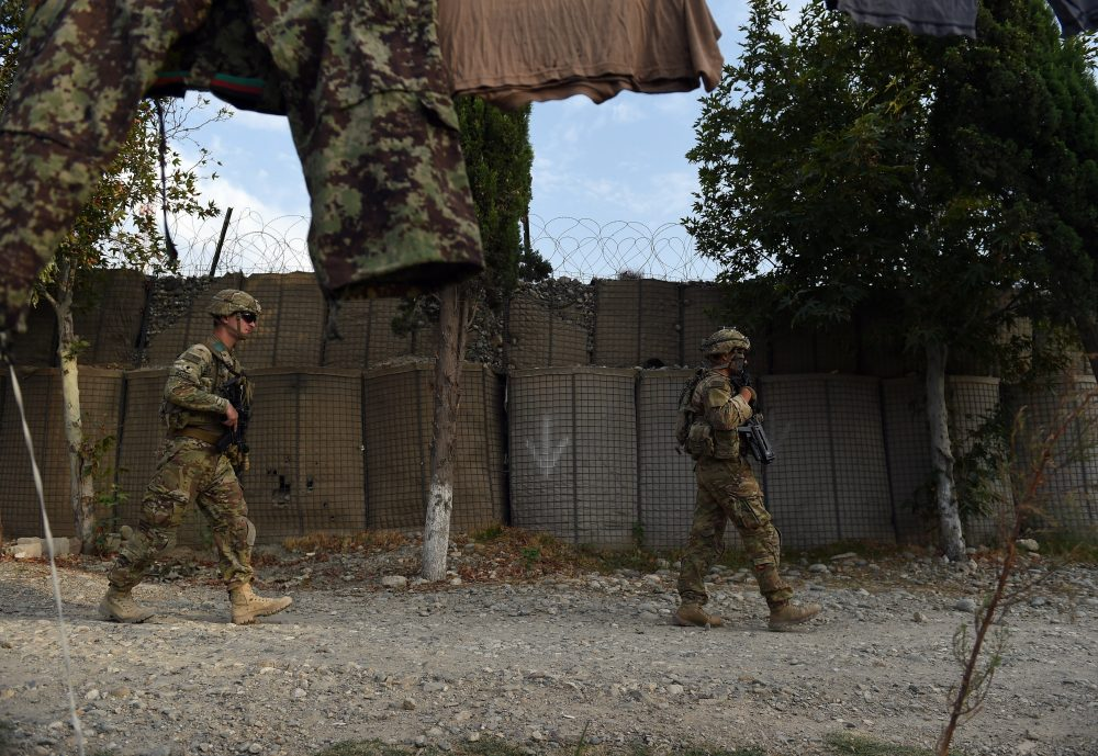 In this 2015 photograph, U.S. soldiers walk past an Afghan National Army base in the Khogyani district in the eastern province of Nangarhar. (Wakil Kohsar/AFP/Getty Images)