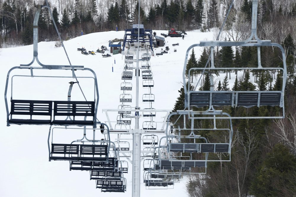 Workers repair the King Pine chairlift at Sugarloaf Mountain Ski Resort in Carrabassett Valley, Maine in March 2015. (Robert F. Bukaty/AP)