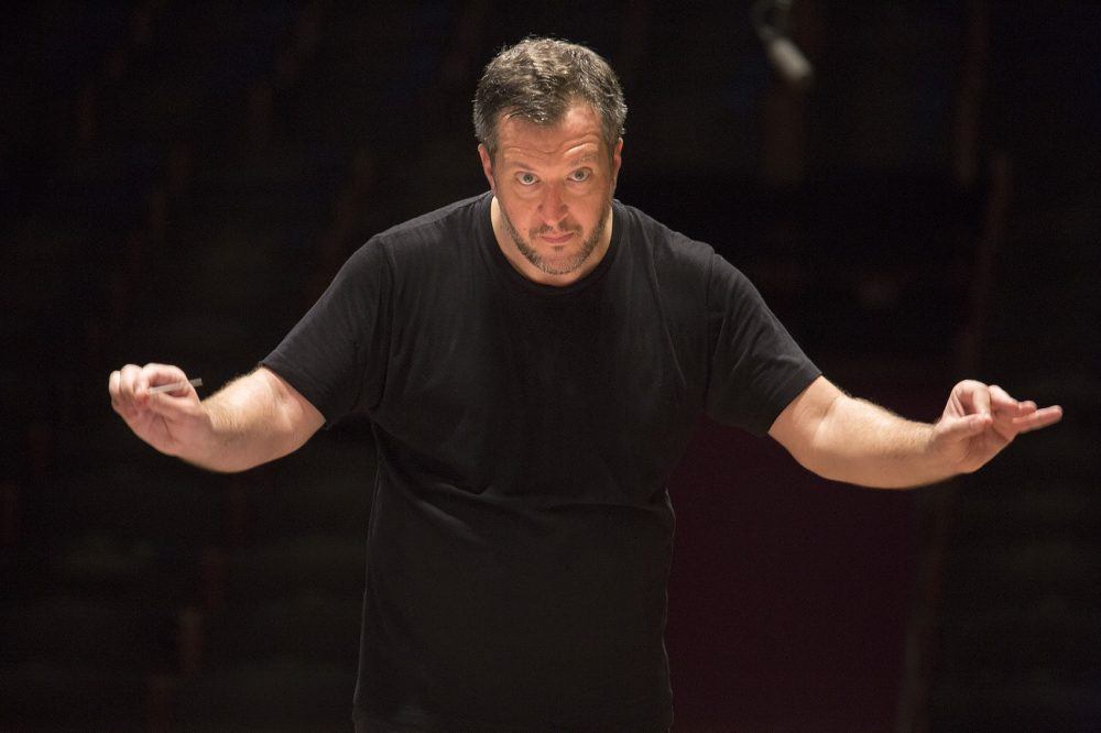 Thomas Adès, the Boston Symphony Orchestra's first artistic partner, conducts the BSO during a rehearsal at Symphony Hall. (Jesse Costa/WBUR)