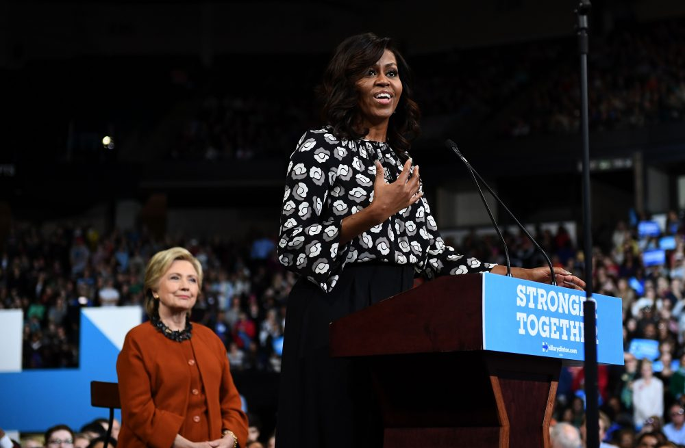 First Lady Michelle Obama speaks as Democratic presidential nominee Hillary Clinton listens during a campaign rally in Winston-Salem, N.C., on Oct. 27, 2016. (Jewel Samad/AFP/Getty Images)