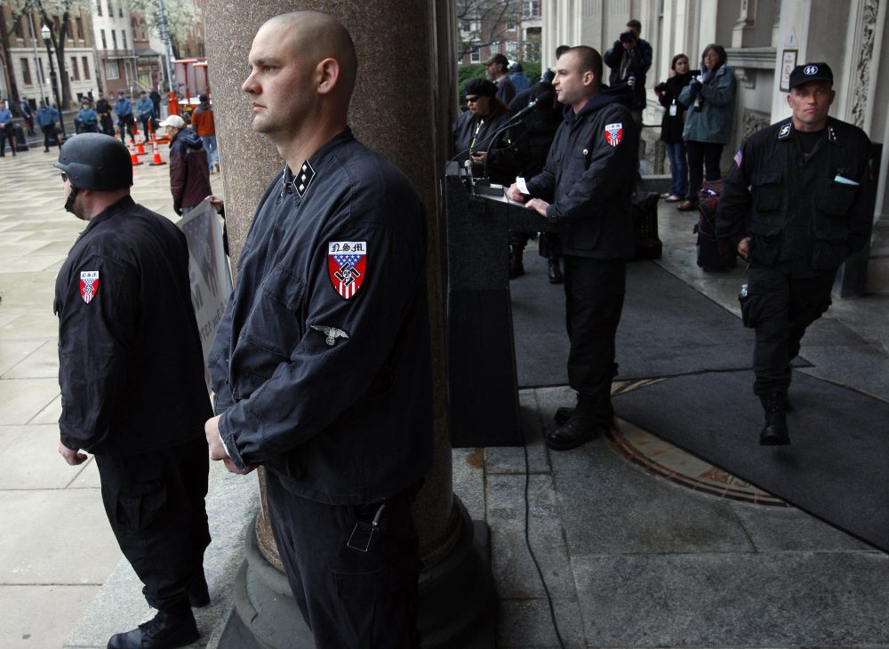 Guards of the neo-Nazi National Socialist Movement stand nearby as Commander Jeff Schoep speaks at a rally Saturday, April 16, 2011, on the steps of the statehouse in Trenton, N.J. (Mel Evans/AP)