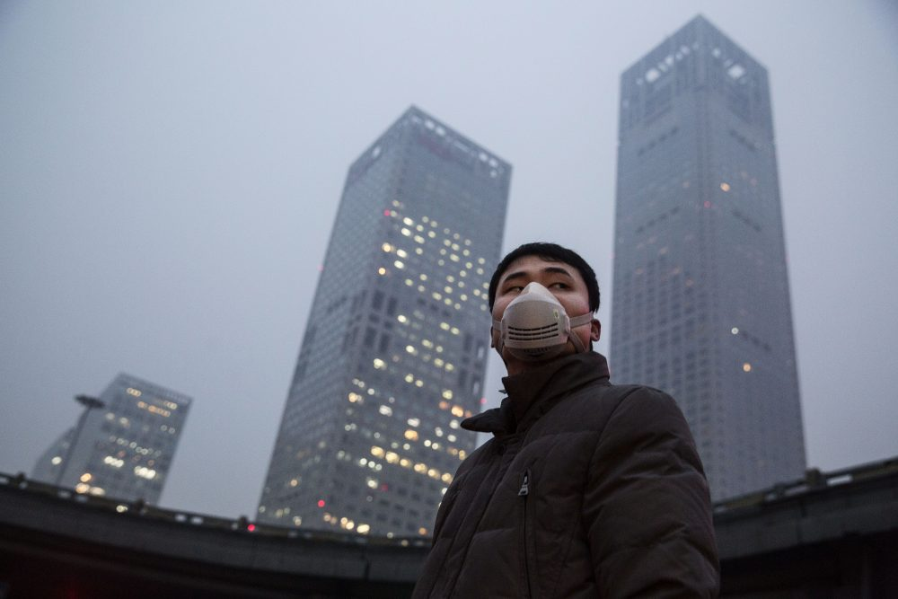 A Chinese man wears a mask to protect against pollution in heavy smog on Dec. 8, 2015 in Beijing, China. (Kevin Frayer/Getty Images)
